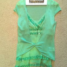 Green sequin tank with shrug Green sequin tank with shrug. Shrug has 2 tiny snags on back but barely noticeable. Pictures above. bebe Tops Camisoles