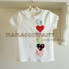***this tee is RESERVED for Anapcal, thank you!***    applique hearts in our favorite fabrics line this cute tee!      we have other size tanks and