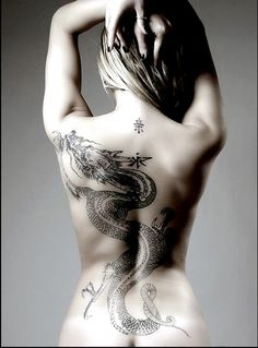 Sizzling Japanese Dragon tattoo on her back. For more tattoos designs and ideas visit www.tattooenigma.com