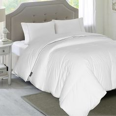 Refresh your master suite or guest room with this lovely comforter, featuring a 1200 thread count and hypoallergenic white down fill.  ...