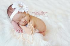 I love these newborn pictures with the baby girl in pearls! So girly!