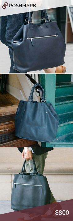 """Shinola Navy Large Leather Tote DESIGNED & DEVELOPED ENTIRELY AT OUR DETROIT STUDIO, EVERY PIECE IN THE SHINOLA LEATHER COLLECTION IS HANDCRAFTED AND BUILT TO LAST A LIFETIME   DURABLE NUBUCK LEATHER  BRANDED RIVETS AND SWIVEL SNAPS  EXTERIOR ZIPPER POCKET  THREE INTERIOR SLIP POCKETS  HAND-SEWN WHIPSTITCHED INTERNAL CARD POCKET  CLASSIC EVERYDAY BAG  Dimensions15"""" H X 20"""" W X 8"""" D, 6"""" HANDLE DROP 