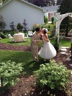 True love. T-length wedding dress. Blusher. Champange toast. Harbor. Backyard wedding. Blusher. Vintage.
