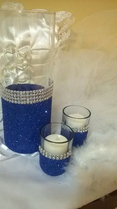 Royal blue glitter vase, royal blue theme wedding centerpieces Glass vase with your choice of color glitter . Add that extra sparkle to your event. Cylinder vase is 7 H THIS LISTING IS FOR THE VASE ONLY THIS IS A SAMPLE VASE your purchase will be made to order. If you need a custom order let me know any specific ideas you have and I will create something just for you