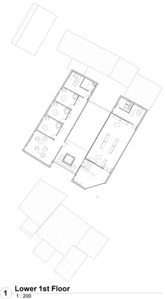 First Floor plan with public on one side a privt writers rooms on the othe. All divided by a central core of open space an light.