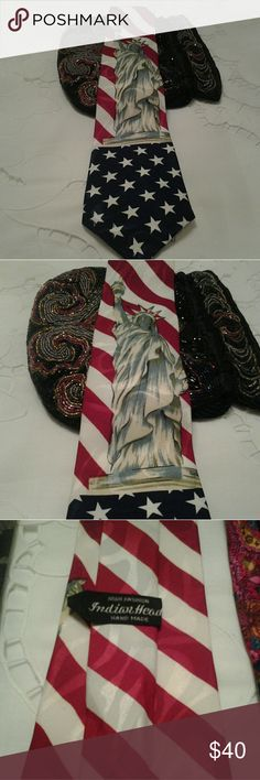 VINTAGE, INDIAN HEAD STATUE OF LIBERTY TIE I HAVE A VERY UNIQUE  AMERICAN FLAG HAND MADE TIE FROM INDIAN HEAD.  IT HAS VERY VIBRANT RED, WHITE AND BLUES, WITH THE STATUE OF LIBERTY ON THE FRONT.  IT IS 58 INCHES LONG AND 4 INCHES AT THE WIDEST POINT.   IT IS IN EXCELLANT CONDITION,.  THIS WOULD BE A GREAT PATRIOTIC TIE TO OWN TO SUPPORT OUR COUNTRY.   IF YOU HAVE ANY QUESTIONS ABOUT THIS TIE, PLEASE ASK. INDIAN HEAD Accessories Ties