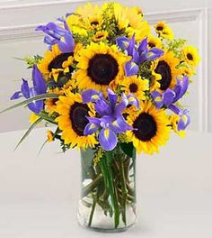 Google Image Result for http://www.giftsflorist2000.com/catalog/images/vase-sunflowers2.jpg