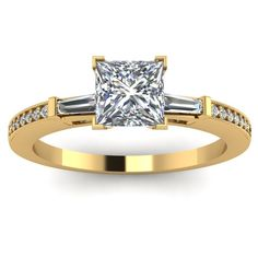 Princess Cut Baguette Accent Engagement Ring - Lavish is the very first thing that comes to mind when it comes to this 14K Yellow Gold Princess Cut Baguette Accent Engagement Ring placed in a Pave & Bar setting featuring a .55 carat Princess center stone surrounded by 16 stunning White Princess & Baguette accent sides stones. The accented ring comes with a VVS1 in clarity with an H in color & the total gem weight is equal to .70 carats. The diamonds are 100% natural. #unusualengagementrings