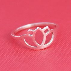 Forgiving the glaring pink background.... I would like a lotus ring.
