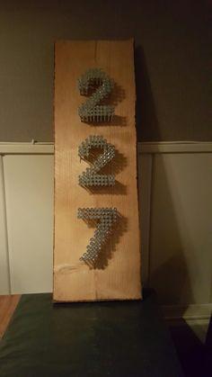 Huisnummer van schroeven zelf gemaakt