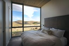 """Architecture firm Imbue Design has designed this off-grid residence on a desolate lot in Idaho for a family to """"distance themselves from social stresses"""". City Living, Living Spaces, Architectural Floor Plans, Black Fireplace, Design Strategy, Architect Design, Interior Walls, Mid Century Design, Cladding"""
