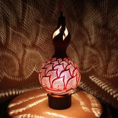 A gourd carved and turned into this awesome light throwing lamp.