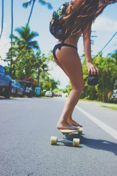 longboarding on the way to the beach