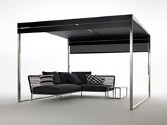 Pergola XG1 sunshade in satin-finish stainless steel, polyurethane, and plasticized mesh, with Nest sofa and side table in stainless steel by Coro Italia, through Lepere
