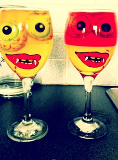 DIY Halloween jelly glasses Handpainted Wineglasses by memories like this and fill it up with jelly and eyeballs