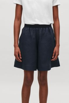 Model side image of Cos elastic-waist linen shorts in blue