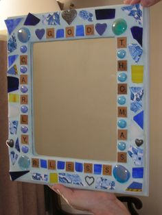 This is a mosaic mirror I made for Carly and Thomas in celebration of their wedding.