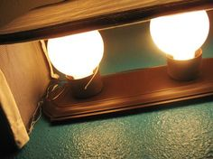 vanity light cover diy - could use a premade adjustable curtain rod...