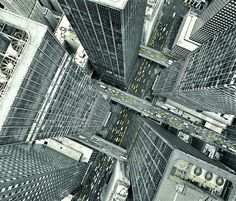 Extreme angle of buildings looking directly down. One point perspective makes it look like the buildings are getting smaller as they go down.