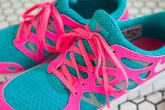 Neon pink and Turquoise Nike shoes.