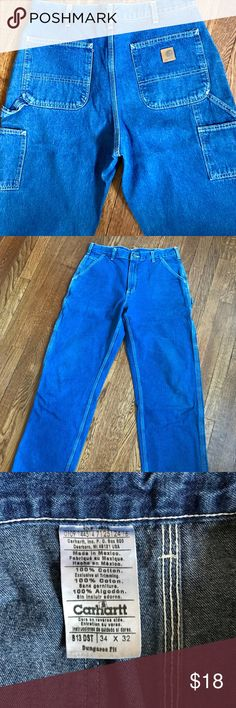 Carhartt Men's Dungaree Fit Jeans Size 34W 32L Men's blue 8 pocket painters utility pants by Carhartt. These are built to last! They are a dungaree fit. Excellent like new condition.  Measurements: Waist - 34 Length - 32 Carhartt Jeans Relaxed