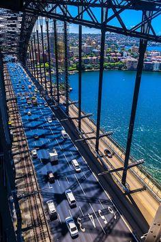 Sydney Harbour Bridge, Australia. It carries 8 road lanes, 2 rail tracks, 1 pedestrian way and 1 cycleway