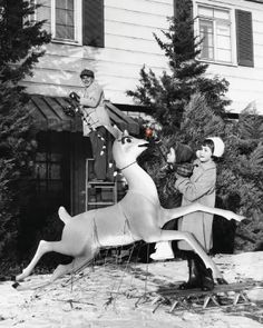 Stringing up the lights and other great pics of Christmas moments from long ago