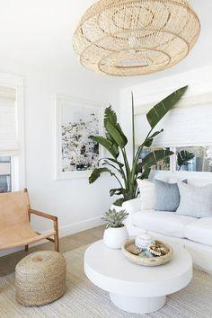 Living Room Design Ideas in this Upscale Coastal Bungalow Surf Style Beach House Beach House Tours #coastalliving #coastaldesign #beachhouses #beachhousedesign #airy #airyhomedesign #whitedesign #surfdesign #boho #bohemiandesign #neutralcolors