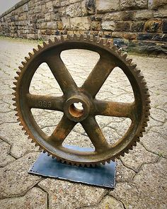 Industrial Gear Art Centerpiece Stands just over 12 tall and weighs about 20lbs. Welded to