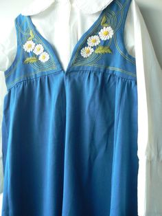 """Swedish National Folk Costume, size medium, consisting of a hand made dress, probably a mixture of cotton/wool and an apron with lovely hand embroideries + a cotton blouse.  Dress: length 52"""", breast about 40"""" Blouse: breast 44"""", length of arms:18"""" Apron: 32"""" long and 33"""" wide"""