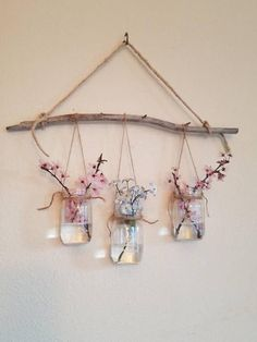 Mini Mason Jars Hanging Wall Vase This mini multiple vase, gives dimension to a space, is a wonderful way to bring a bit of nature indoors. It is 17 Mini Mason Jars, Mason Jar Crafts, Home Crafts, Diy Home Decor, Diy And Crafts, Wooden Crafts, Hanging Wall Vase, Hanging Jars, Hanging Plant