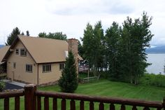 View from deck towards neighbor on left. Tall trees will be planted to screen the view.