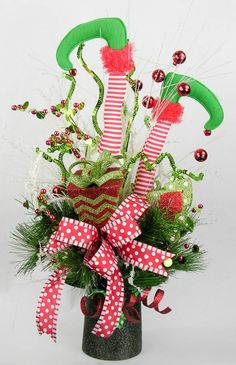 Decorate your home with this fun holiday arrangement ready to accent any place in your decor you want to add a little fun and whimsy. Striped elf legs with jingle bells with curly sequinned picks, Office Christmas, Grinch Christmas, Christmas Love, Christmas Projects, Holiday Crafts, Christmas Ideas, Christmas Thoughts, Cheap Christmas, Christmas Games