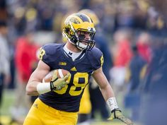 Michigan tight end Jake Butt runs with the ball during