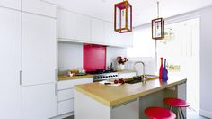 Modern White Fitted Kitchen with Pink Accents
