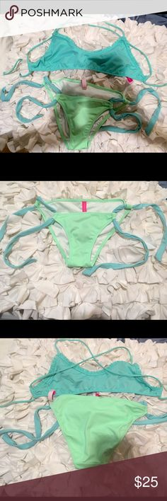 Victoria's Secret bikini Top is medium but runs small. The bottoms are XS. Mix and match pair. Great condition. Worn only once. Victoria's Secret Swim Bikinis