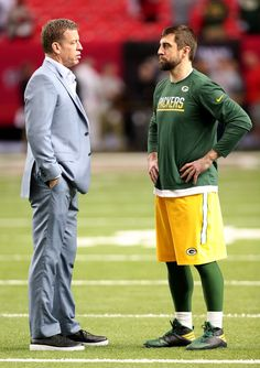 Aaron Rodgers Photos Photos - Troy Aikman of FOX Sports talks with quarterback Aaron Rodgers #12 of the Green Bay Packers before the NFC Championship Game at the Georgia Dome on January 22, 2017 in Atlanta, Georgia. - NFC Championship - Green Bay Packers v Atlanta Falcons