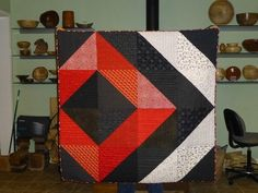 Simple, large HSTs in this quilt by LaDawna of Purrfect Stitchers.
