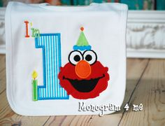 Super Super cute for the 1st Birthday Party! Love Elmo birthday parties. Velcros at the back of the neck. Brand name is Monag. 100% cotton. Width- 9