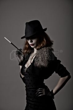 pictures of black women smoking cigarettes - Retro shot of gangster woman in fedora hat and evening dress holding mouthpiece Stock Photo - Budget Royalty-Free & Subscription, Code: Gangster Outfit, Mafia Outfit, Gangster Costumes, Mafia Gangster, 1920s Gangsters, Women Smoking Cigarettes, Suits For Women, Clothes For Women, Fedora Hat