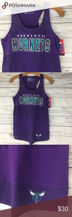 """NBA Charlotte Hornets mesh net racerback tank top NBA Charlotte Hornets racerback tank top with mesh netting on the front for some subtle flirtiness. The hornet mascot is on the bottom left side. Measurements pit to pit 15.5"""", length 25"""" NBA Tops Tank Tops"""