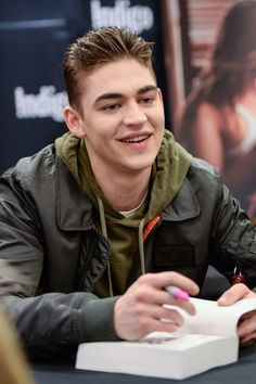 """Hero Fiennes Tiffin attends the """"After"""" book signing at Indigo."""