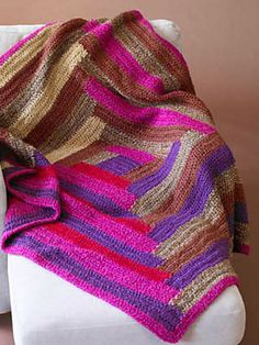 Log Cabin Afghan in chocolate, violets, and magenta. Pretty! Free pattern by Lion Brand.