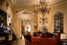 Mario Buatta's collection of 18th-, 19th-, and early-20th-century ceramics is displayed in his entry hall/dining room.