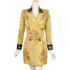 Inspired by an 18th century French brocade fabric this exquisite silk brocade coat from Jean Patou has been made contemporary by Christian Lacroix.