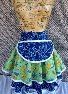 This cute apron features Finn and Jake from Adventure Time. Super Fun for anybody to wear.  Mathamatical!!    One of a kind apron that is perfect