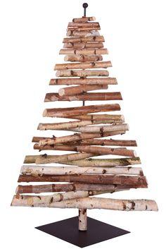 Sapin composé de petits rondins de bois chez Fleux' : Des sapins de Noël pas comme les autres - Journal des Femmes