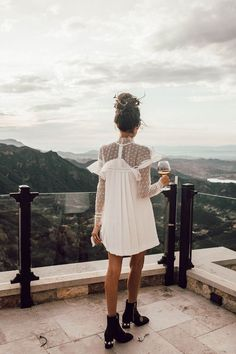 ::white lace long sleeve mini dress and black heeled booties::