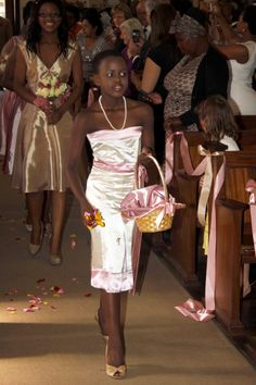 A stunning flowergirl adds to the anticipation of seeing the bride.