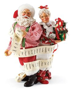 Wrapped up in their Work - Santa and Mrs Claus